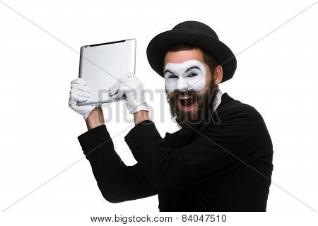 mime as a businessman throws computer in rage.