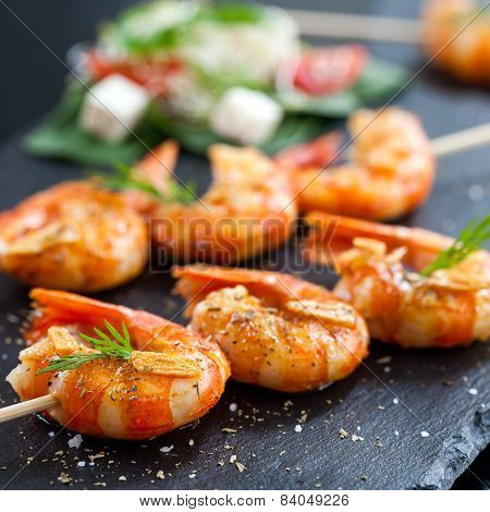 Shrimp Tails Grilled On Wood Skewer.