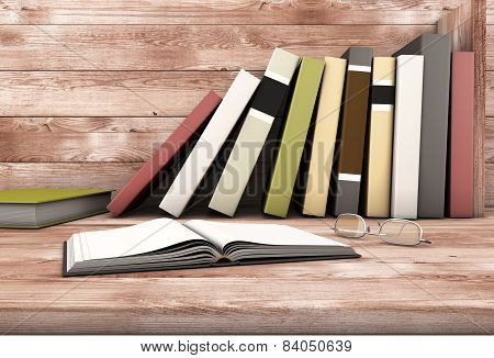 The Open Book And Glasses Against The Wooden Shelf With Books