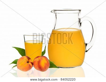 Peach Juice In A Glass And Carafe