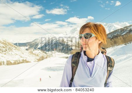 Cheerful Female Skier In Ski Resort