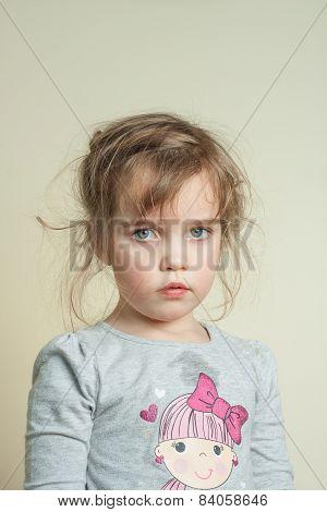 adorable grumpy little girl with big eyes