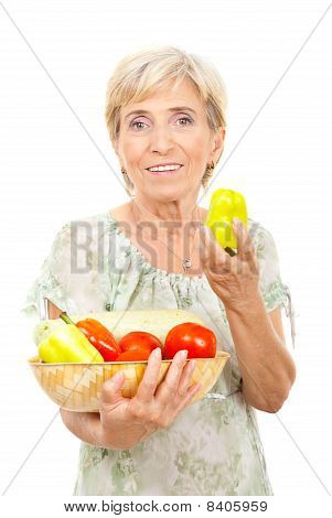 Senior Woman Showing A Green Pepper