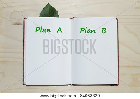 Open notebook with Plan A-Plan B message
