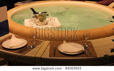 Pool With A Bucket With Bottle Of Champagne