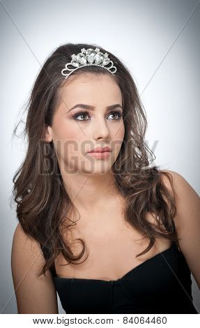 Hairstyle and make up - beautiful female art portrait with beautiful eyes. Genuine natural brunette