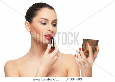 Beautiful Young Woman Putting Lipstick On Lips