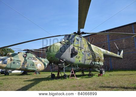 Old military helicopter on an airport