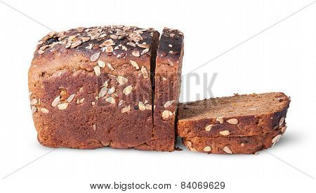 Half And Slices Of Black Unleavened Bread With Seeds