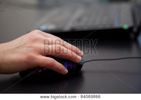 Woman Hand On Mouse At Laptop