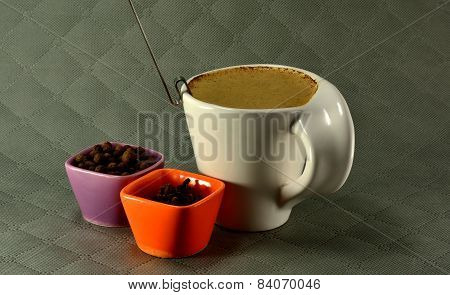Cup Of Coffee With Milk And Spices Seed Grain