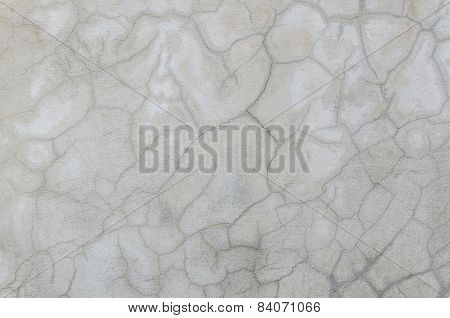 Abstract Of Cement Cracked Texture On Old White Masonry Wall