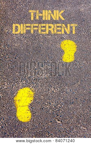 Yellow Footsteps On Sidewalk Towards Think Different Message