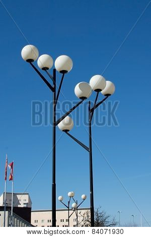Functionalism style lamp posts detail in fifties suburb