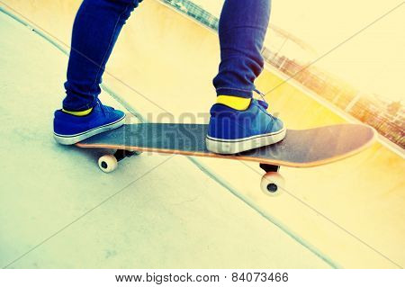 skateboarding woman legs at skatepark