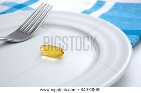 Capsule on white plate