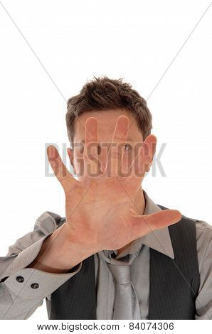 Man Holding Hand For Face.