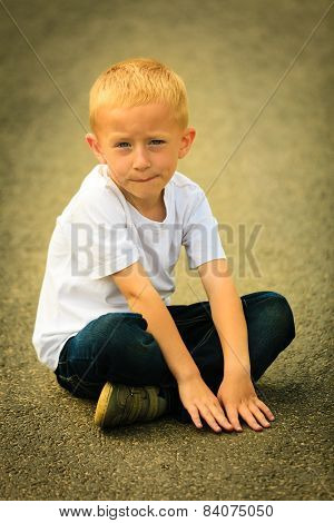 Little Thoughtful Boy Child Portrait Outdoor