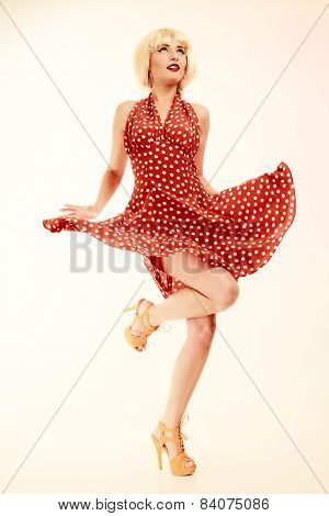 Pinup Girl In Blond Wig Retro Dress Dancing