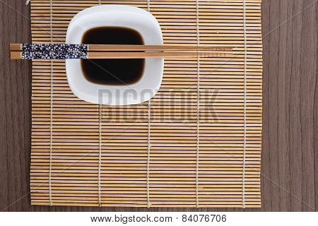 Chopsticks Over Soy Sauce Dish