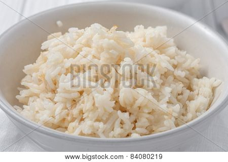a bowl of rice cooked in chicken stock