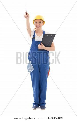 Young Woman In Blue Builder Uniform With Clipboard Pointing At Something Isolated On White