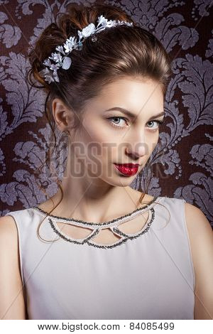 beautiful young sexy sweet girl with large red lips in wedding white wreath on the head