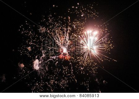 Cluster of colorful fireworks against dark sky