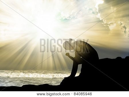 Woman praying to god at sunset