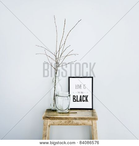 Motivational Frame Love Is The New Black  With Glass Bottles. Scandinavian Hipster Style Room Interi