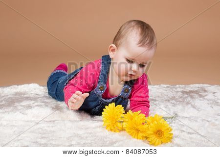 Small Infant Baby With Yellow Flowers