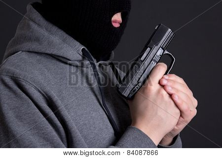 Masked Man Criminal Holding Gun Over Grey