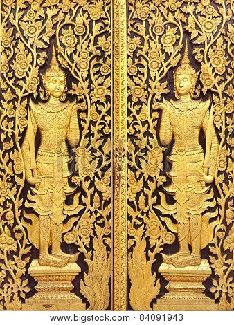 Thai Culture Gold Sculpture On The Temple Wall