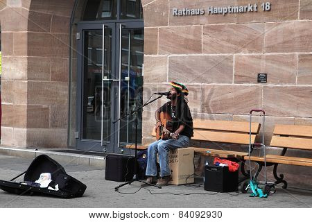 NURNBERG GERMANY - JULY 13 2014: Hauptmarkt the central square of Nuremberg - street musician singin