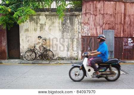 Malaysia, Penang, Georgetown - Circa Jul 2014: Real Bicycle Juxtaposed Over Lifesize Mural Of Childr