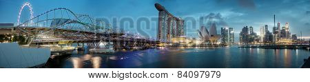 Singapore - 01 Jan 2014: Skyline From The Embankment. High-rise Buildings, Ferris Wheel, Bridge, Art