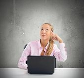 stock photo of intuition  - Businesswoman has an intuition working on pc - JPG