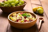 pic of mints  - Vegetarian couscous salad with grapes pomegranate walnuts cheese lime and mint in wooden bowl photographed with natural light  - JPG