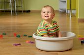 image of tub  - cute blond kid sitting in white tub - JPG