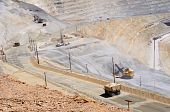 stock photo of porphyry  - Giant Water Truck Keeps Dust Down at Copper Mine