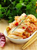 stock photo of kimchi  - Korean cabbage kimchi with hot red pepper - JPG