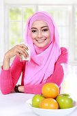 pic of muslimah  - portrait of beautiful young muslim woman had a milk and fruits for breakfast - JPG