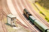 picture of locomotive  - signal box and locomotive on a miniature model train set  - JPG