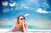 stock photo of redhead  - Redhead girl on the beach in spring time - JPG