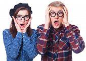 stock photo of nerd glasses  - Nerd teen couple in glasses on white background - JPG