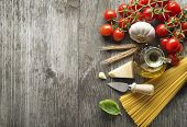 image of spaghetti  - Spaghetti and tomatoes with parmesan cheese on a vintage wooden table - JPG