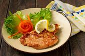 image of wieners  - Wiener Schnitzel of pork with vegetables on the decoration of the plates - JPG