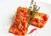 pic of enchiladas  - Mexican chicken enchiladas with spicy tomato sauce and cheese on white plate - JPG