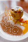 stock photo of white sugar  - Baked apple with honey beautifully decorated white powdered sugar and a cup of coffee - JPG