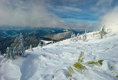 stock photo of snow clouds  - Winter Carpathian mountains all covered with snow in the sky beautiful clouds - JPG